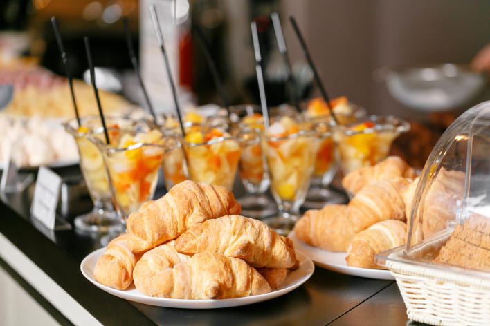 Croissants and fruit cups