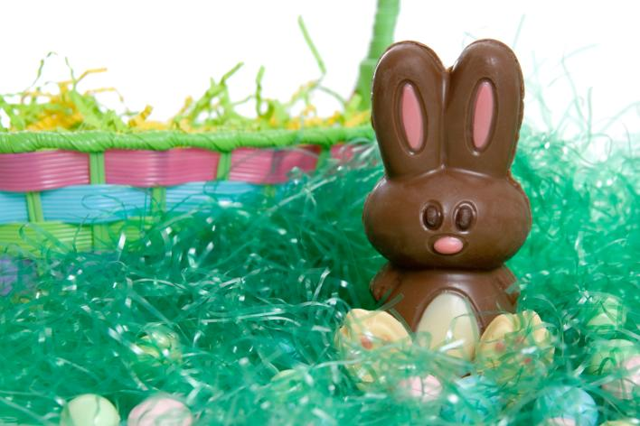 Chocolate easter bunny set in front of an easter basket
