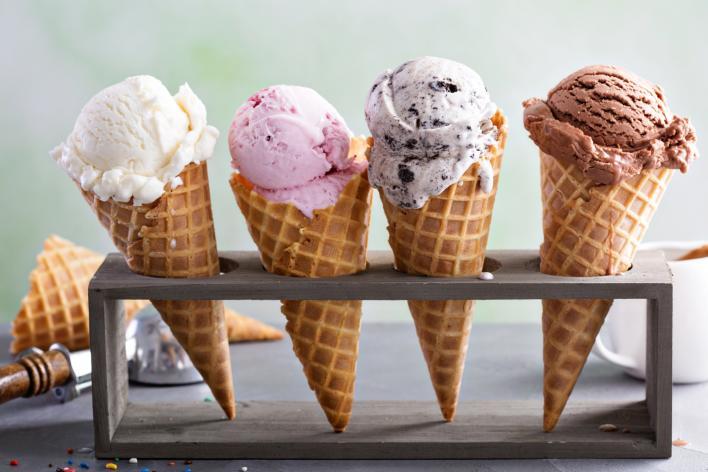 4 ice cream cones in a wooden holder