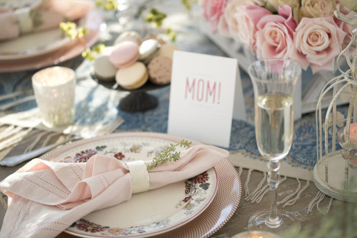 table place setting with mom place card, pink flowers, macaroons, champagne