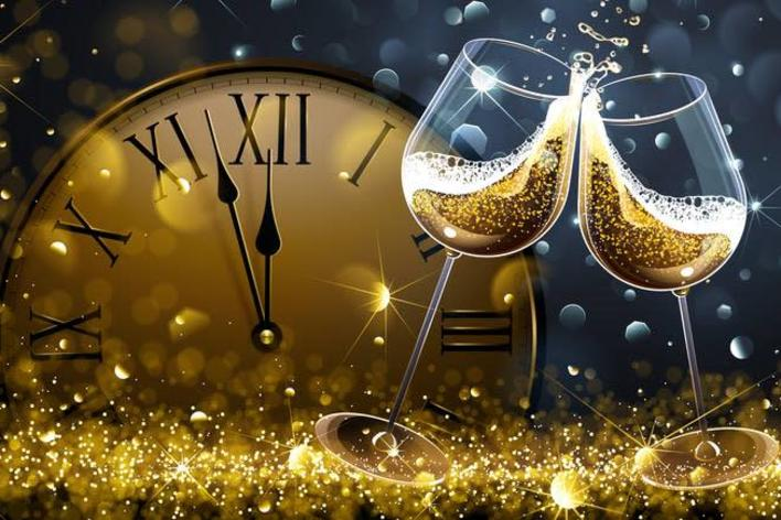 Gold clock and wine glasses surrounded by glitter