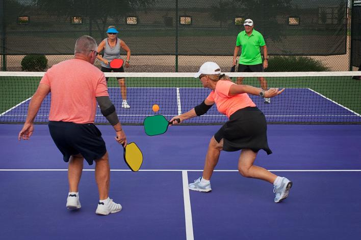 2 couples playing pickleball