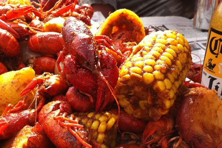 Tim's Rivershore Crawdad Festival photo of crawdads, corn and a Corona