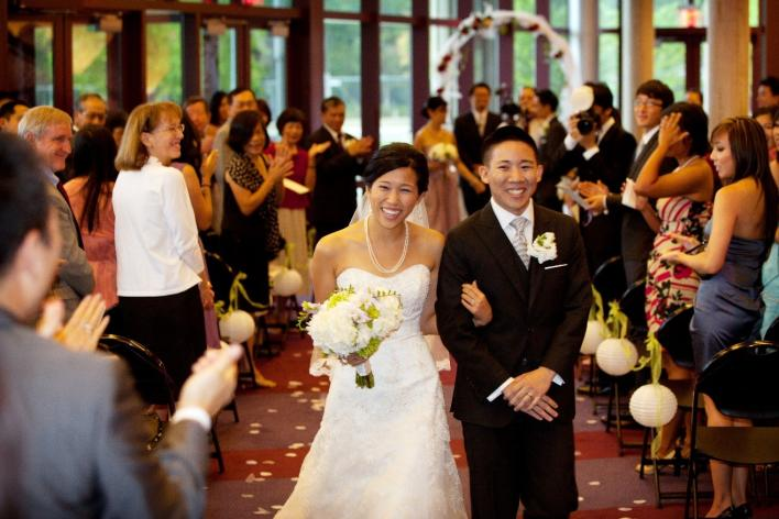 Asian Couple walking down isle for wedding