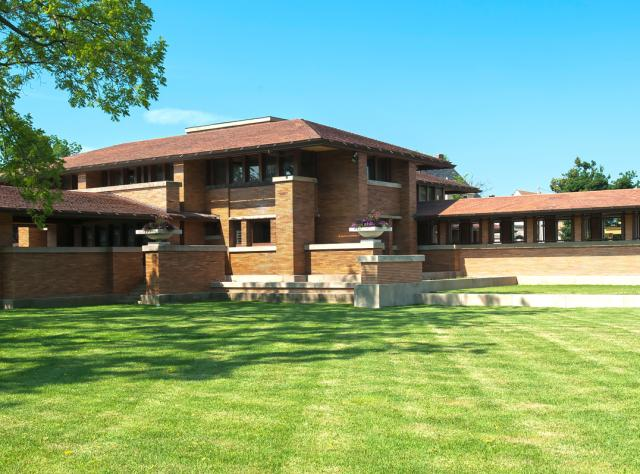 The exterior of Frank Lloyd Wright's Martin House on a sunny day