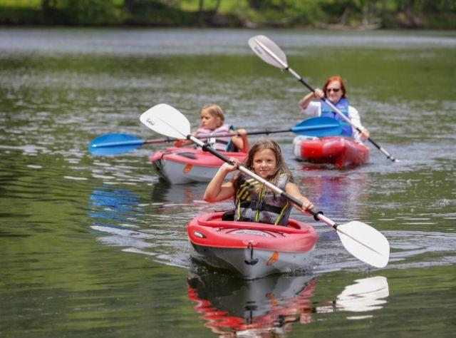 A photo of two girls and their mom kayaking at Mongaup Pond Campground