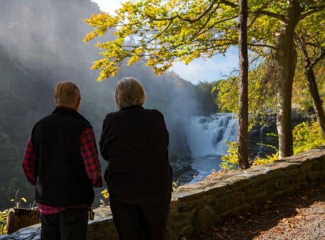 A couple looks at Upper Falls at Letchworth State Park from a distance
