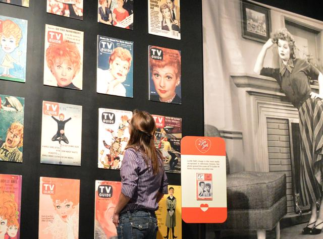 A girl standing and looking at a display at the Lucille Ball Desi Arnaz Museum