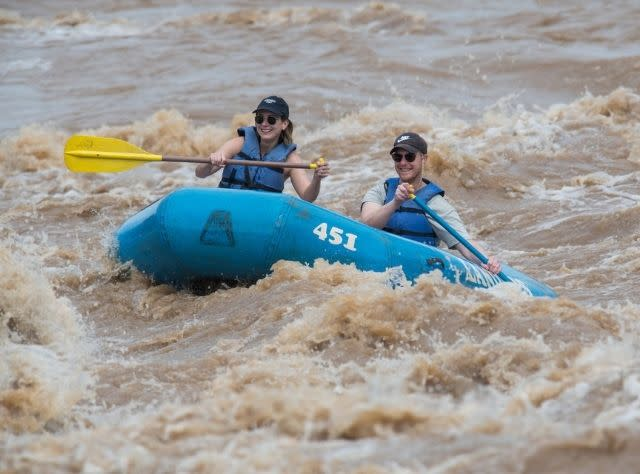 Two people Rafting through Skinners Falls on the Delaware River