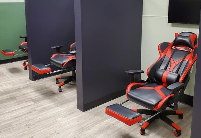 modern gaming chairs in booths