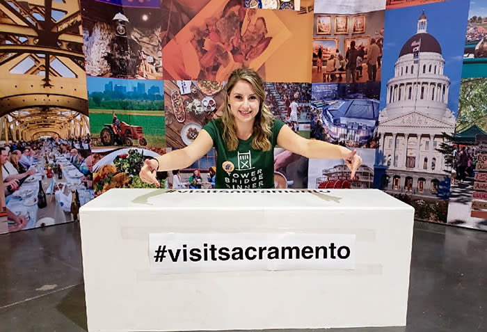 person pointing to #visitsacramento sign