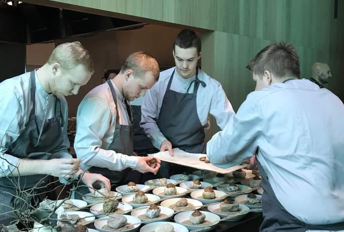Chefs at work at Under underwater restaurant