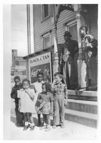 Children stand in front of the Black and Tan in Cheyenne, Wyoming