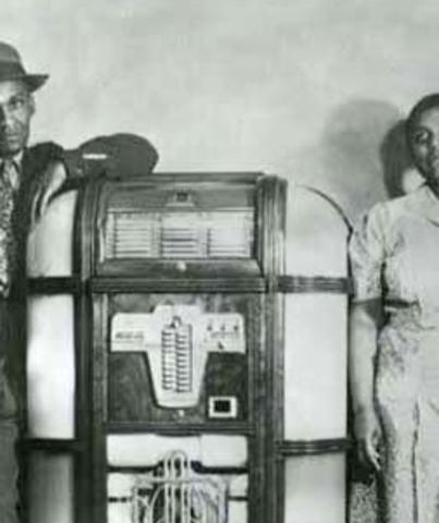 Lola and an unidentified man stand by the jukebox at the Black and Tan Cafe in Cheyenne Wyoming