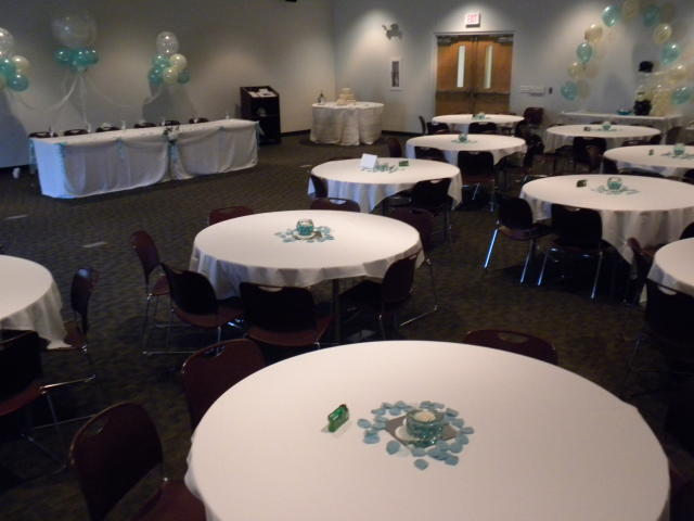 Round Tables with White Tablecloths