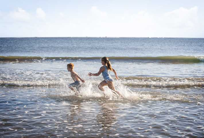 Children playing in the ocean
