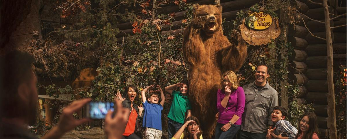 A family poses for a photo in Bass Pro Shops in Springfield, Missouri