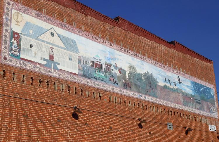 Lee Mims Mural on the side of a Clayton building