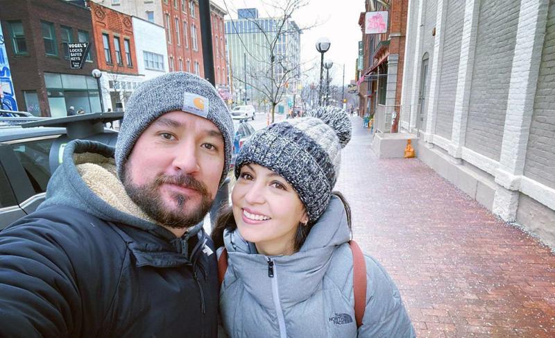 Couple taking selfie in Downtown Ann Arbor