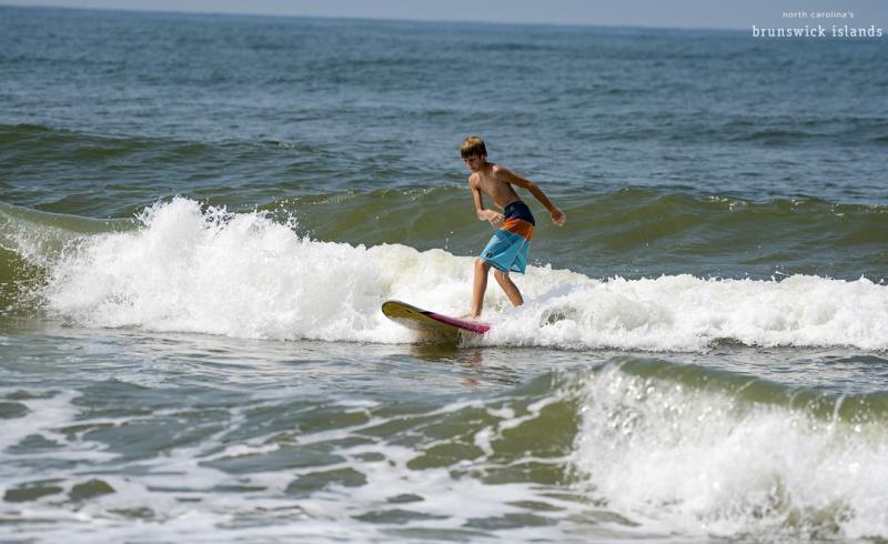Boy surfing in Oak Island, North Carolina.