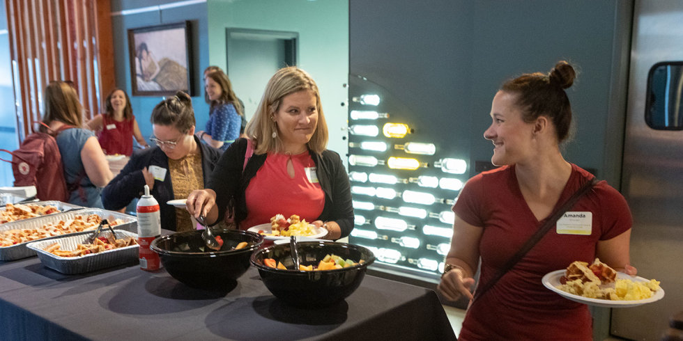 Event attendees treat themselves to a breakfast buffet