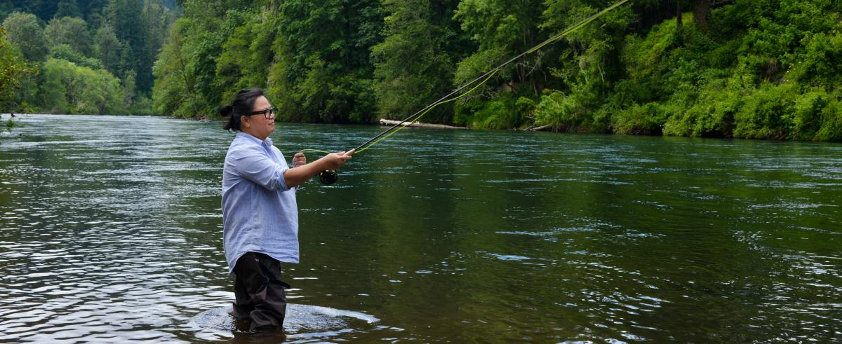 Woman Fly Fishing on the McKenzie River by Melanie Griffin