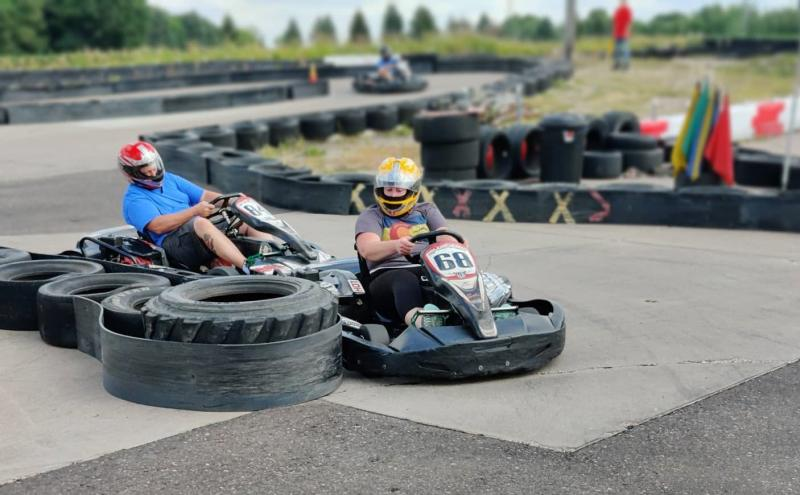 Two race car drivers taking a turn