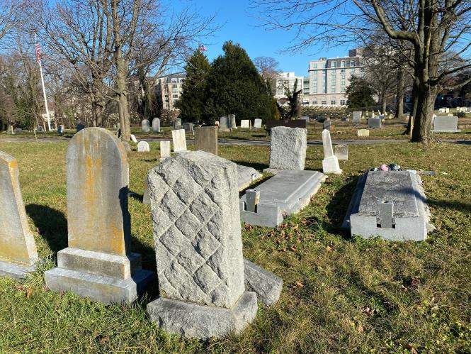 A close up of gravestones at Brewer Hill Cemetery.