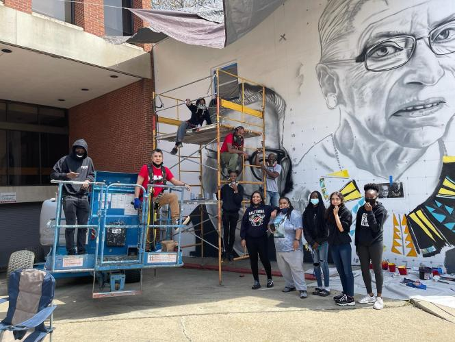 A mural in progress with the Kids making History Mural team.