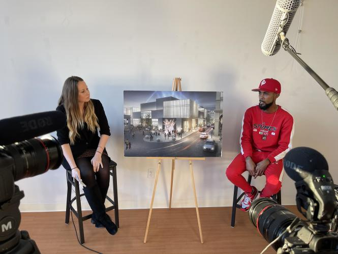 Exceutive Director Mattie Fenton interviewing artist Comacell brown about the Carr's Beach mural.