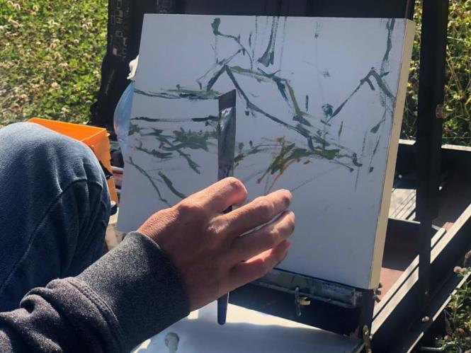 An artist creates a painting in the Deale Plein Air Festival