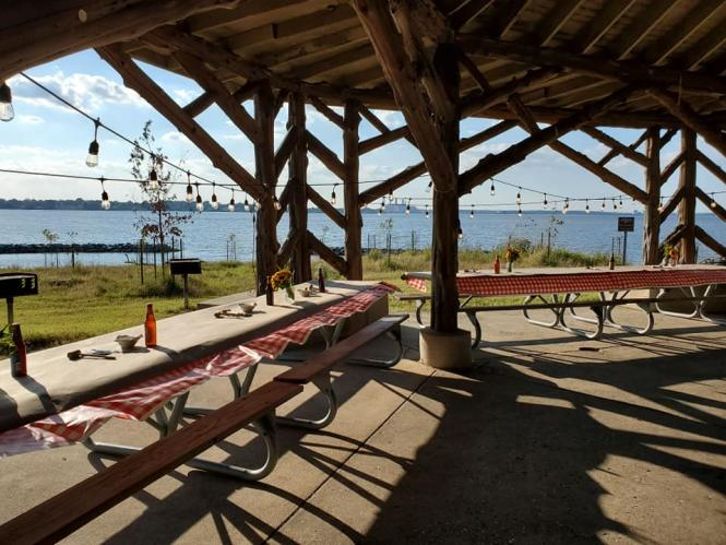 Fort Smallwood Cedar Pavilion set up for a family style Crab Feast