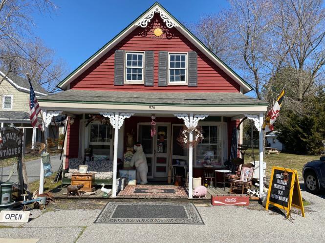 Captain Harvey's has numerous antiques across the porch of their vintage building.
