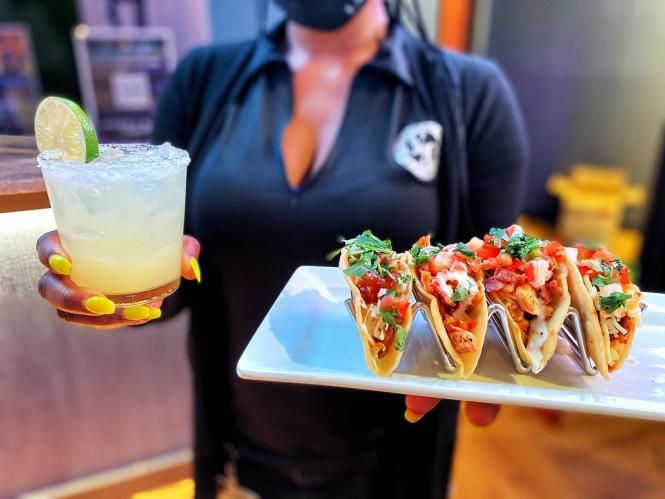 Drinks and tacos are served