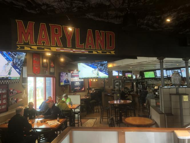 West End Grill interior has a large University of Maryland banner.