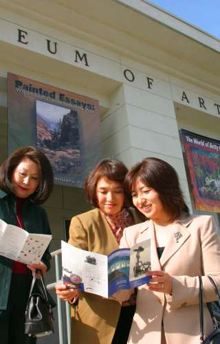 Ladies Looking at Brochure