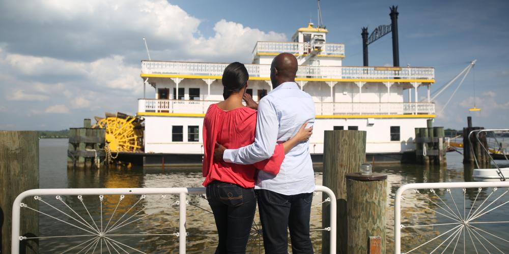 Couple Watching A Ferry At The Potomac Waterfront