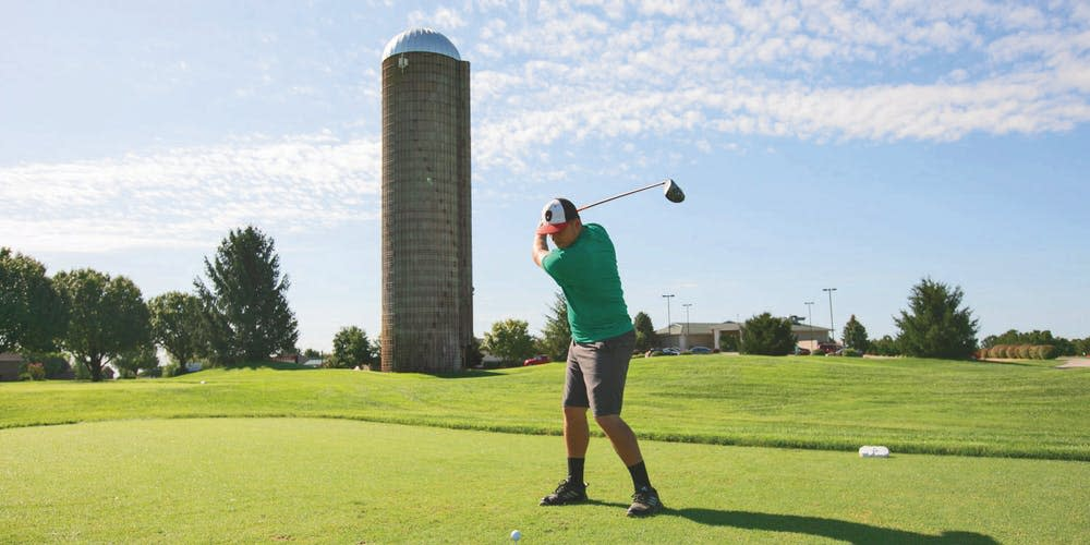 Teeing off in front of the silo at Silo Ridge Community Golf Course.