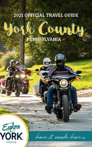 2021 Official York County Travel Guide, featuring several motorcycle riders driving down a sunny road together