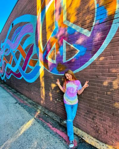 girl with mural at Mellow Mushroom