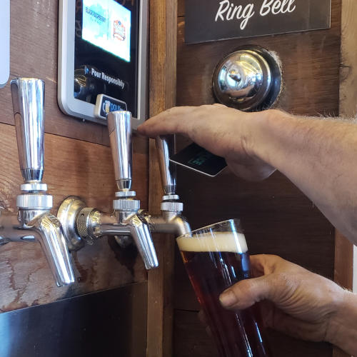 Beer poring from a tap at Accomplice Brewing Company in Cheyenne, Wyoming.
