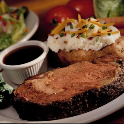 A picture of a steak, potato and a side salad at Rafferty's