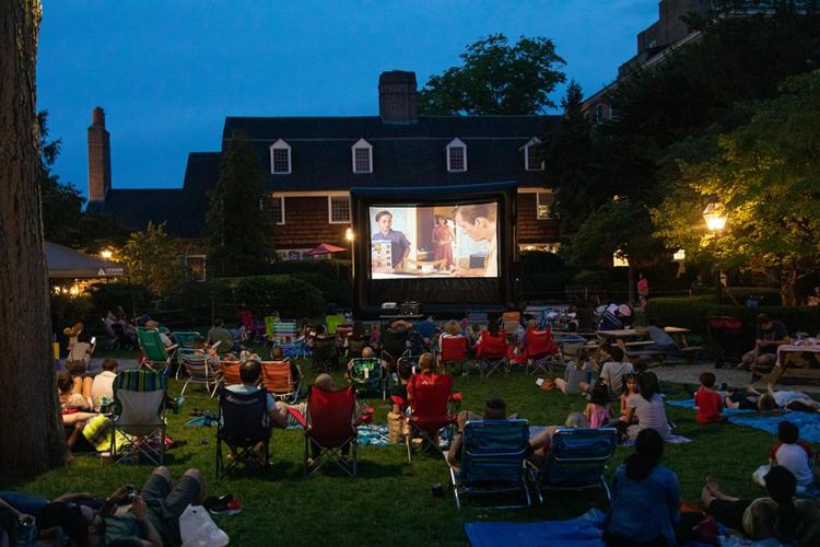 People in lawn chairs enjoying Movie Nights on the Green in Princeton, NJ.