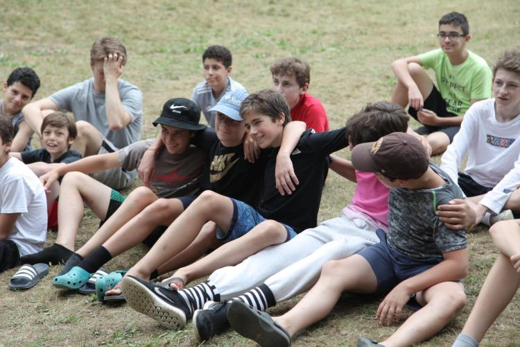 Group of kids sitting in the grass