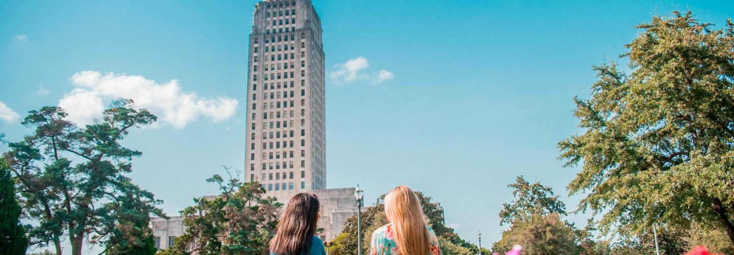 Two girls, garden, capitol building