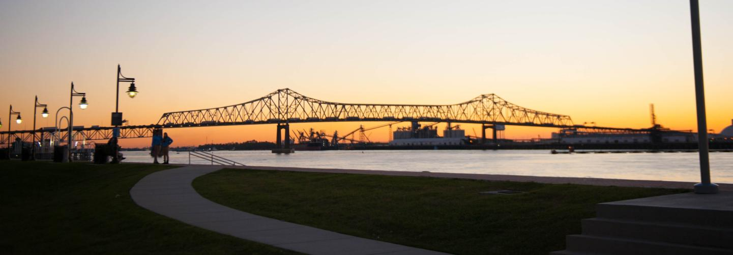 Visitors admore the sun as it sets just past the Horace Wilkinson Bridge in Baton Rouge.