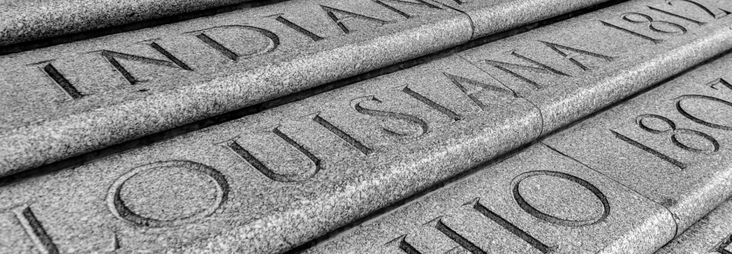 Close up of Louisiana text carved in granite at State Capitol