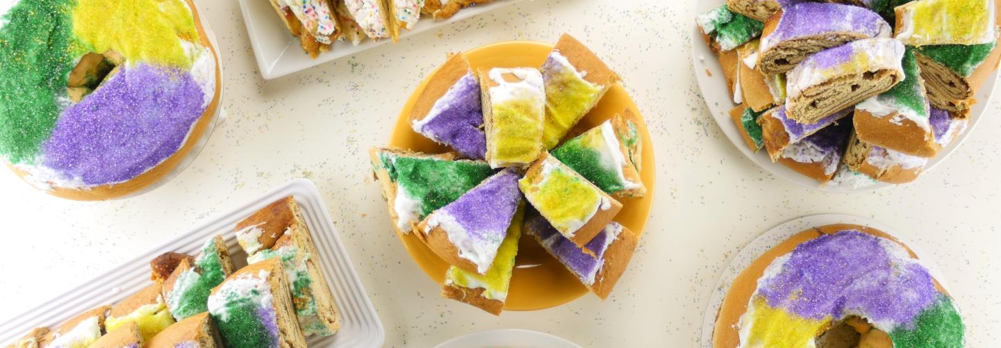 Decorated in the classic Mardi Gras colors, King Cakes come in all shapes and sizes.