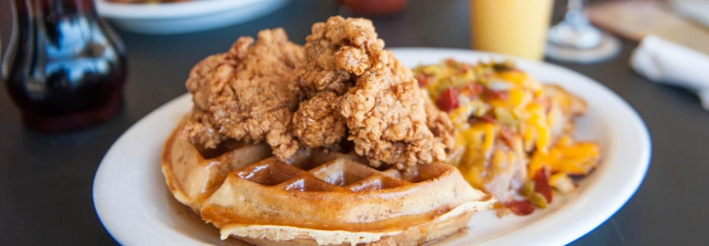 Delicious image of chicken & waffles with side of hash browns