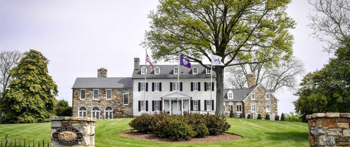 exterior view of The Inn at Evergreen front lawn and manor
